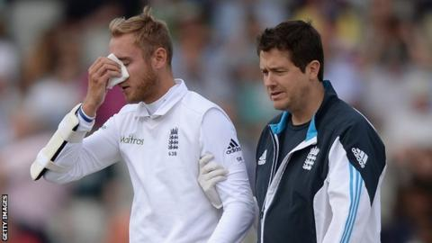 Stuart Broad is escorted from the field after his injury