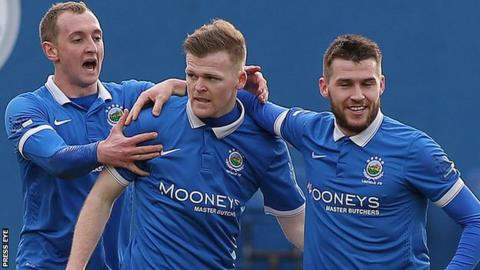 Linfield celebrate Ross Clarke's opening goal against Warrenpoint