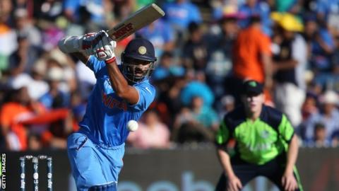 Shikhar Dhawan plays a shot during his innings of 100