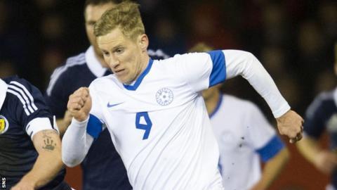 Tarmo Kink in action for Estonia against Scotland