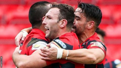Salford's Weller Hauraki (left) is congratulated on his try by Tommy Lee and Rangi Chase (right)
