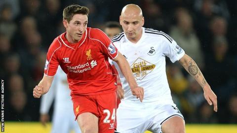 Joer Allen in action against Swansea City's Jonjo Shelvey