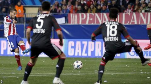 Atletico Madrid's Mario Suarez scores the opening goal
