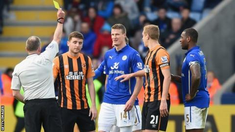 Alex Bruce is shown a yellow card at Leicester