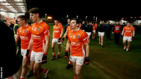 Armagh players walk off after the lights went out at the Athletic Grounds