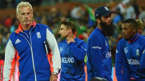 England coach Peter Moores (left) and some England players following defeat by Bangladesh