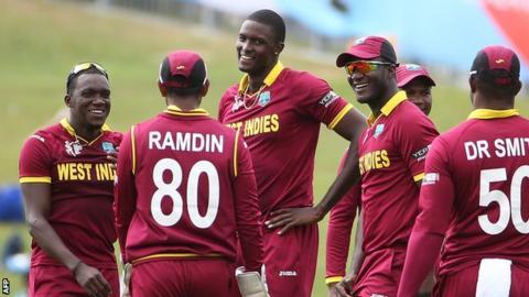 Jason Holder (centre) celebrates a wicket with team-mates