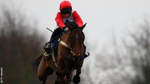 Carruthers winning the Hennessy Gold Cup at Newbury