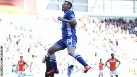 Eoin Doyle celebrates scoring for Cardiff City