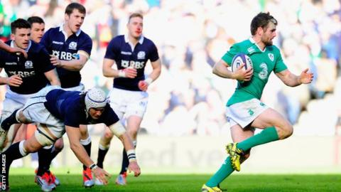 Ireland centre Jared Payne races through to score against Scotland.