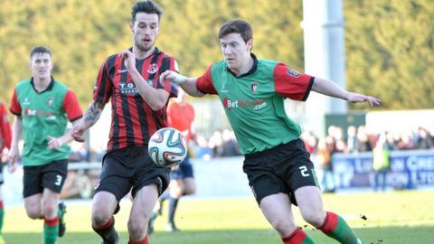 Declan Caddell of Crusaders in Irish Cup semi-final action against Glentoran's Willie Garrett