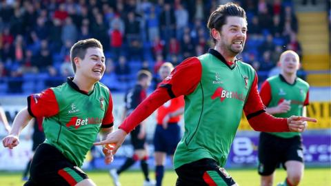 Curtis Allen celebrates with Glentoran team-mates after scoring the goal which secured a 1-0 win over Crusaders in the Irish Cup semi-finals