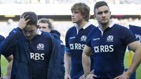 Scotland players show their disappointment against Ireland
