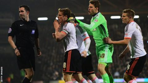 Fulham's Scott Parker, Marcus Bettinelli and Shaun Hutchinson appeal to referee Chris Kavanagh after Kostas Stafylidis was sent off in their defeat by Leeds