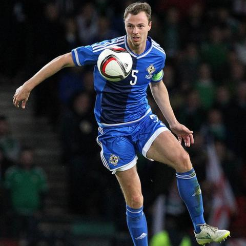 Manchester United defender Jonny Evans returned to the Northern Ireland team for the match in Glasgow