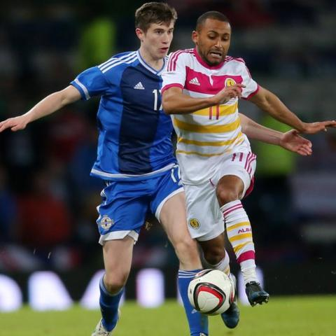 Northern Ireland debutant Patrick McNair competes against Scotland's Ikechi Anya