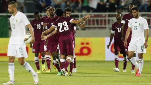 Qatar celebrate their goal