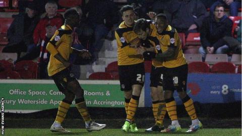 Newport County players celebrate after taking the lead at Accrington Stanley
