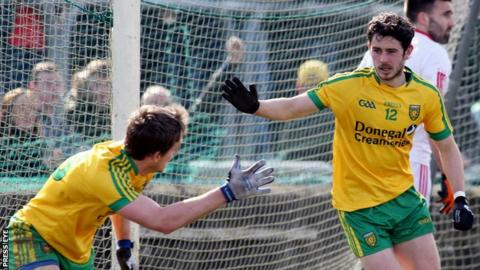 Ryan McHugh is about to be congratulated by Hugh McFadden after scoring Donegal's goal at Ballybofey