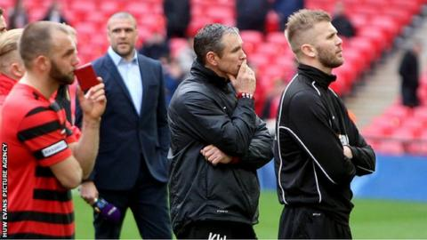 Kevin Wilkin and Wrexham players after losing the FA Trophy final against North Ferriby