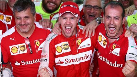 Sebastian Vettel celebrates winning the Malaysian Grand Prix