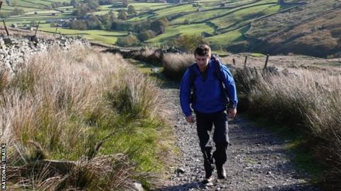 Man walking along a Pennine Way trail