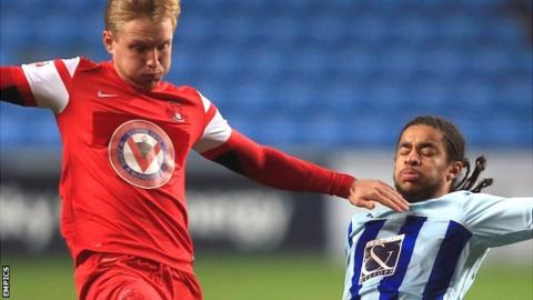 Coventry City's Dominic Samuel battles for ball with Leyton Orient's Josh Wright