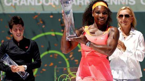 Serena Williams is presented with the Miami trophy by Martina Navratilova