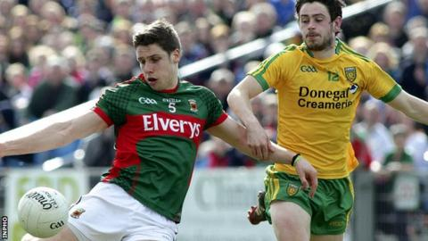 Mayo's Lee Keegan gets a shot in as Ryan McHugh of Donegal closes in