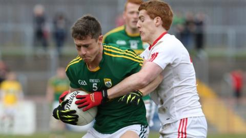 Kerry's Jonathan Lyne attempts to hold off the challenge of Peter Harte of Tyrone