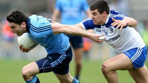 Dublin forward Bernard Brogan attempts to escape the clutches of Monaghan opponent Drew Wylie in the game at Clones