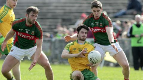 Donegal's Ryan McHugh comes under pressure from Mayo pair Aidan O'Shea and Lee Keegan