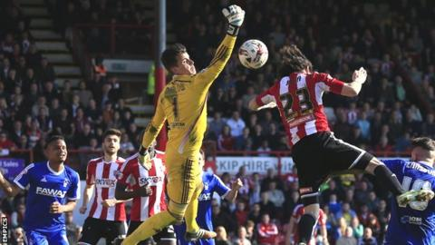 Jota heads Brentford's equaliser past Nottingham Forest's Karl Darlow