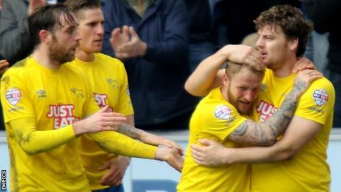 Chris Martin (right) is congratulated after scoring Derby County's opening goal against Wigan Athletic