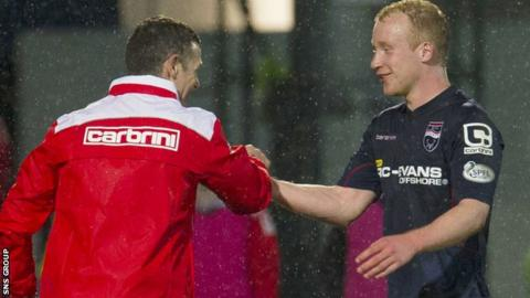 Manager Jim McIntyre congratulates goal-scorer Liam Boyce