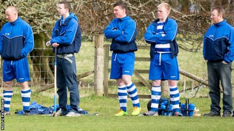 Iain MacKintosh (far right) keeps an eye on the action from the sidelines