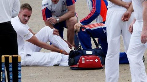 Stuart Broad receives treatment on an injury