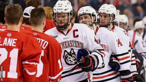 Northeastern University players shake hands with Northeastern University opponents