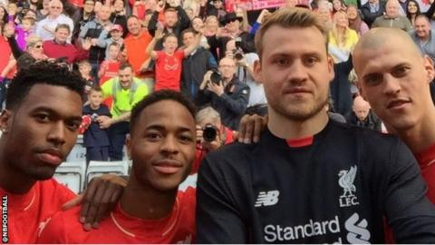 Raheem Sterling, second from left, with Liverpool team-mates, from left, Daniel Sturridge, Simon Mignolet and Martin Skrtel.
