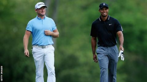 Jamie Donaldson of Wales and Tiger Woods of the United States walk up the fifth hole