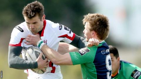 Jared Payne attempts to get past Kieran Marmion in Galway