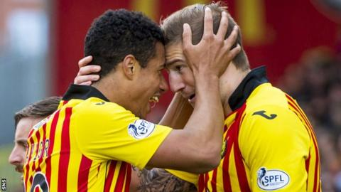 Lyle Taylor (left) scored a double for Partick Thistle in a 2-0 win over Motherwell