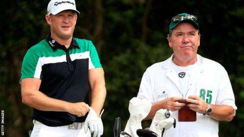 Jamie Donaldson of Wales waits on the second tee alongside caddie Michael Donaghy during the third round