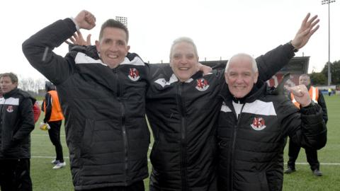 Crusaders manager Stephen Baxter celebrates after the final whistle at Solitude with coaching staff Jeff Spiers and Charlie Murphy