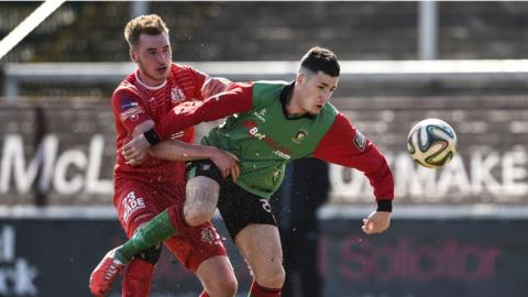 Portadown's Jordan Lyttle vies for possession with Danny McKee of Glentoran as the sides play out a goal-less draw at the Oval