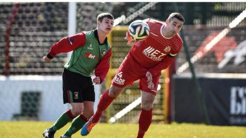 Jordan Stewart and Keith O'Hara in action as Glentoran and Portadown play out a dress rehearsal of their Irish Cup final at the same venue on 2 May