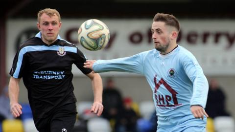 Johnny Taylor and Robbie Hume keep their eyes on the ball as Ballymena run out 2-1 winners over relegated Institute