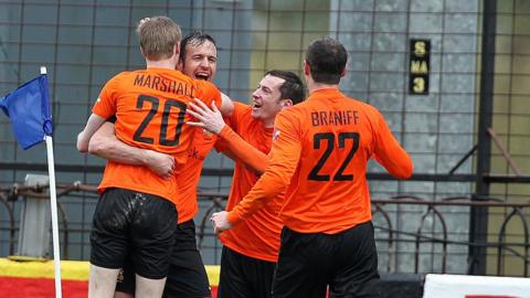 Glenavon goal-scorer Ciaran Martyn is surrounded by team-mates after scoring the second goal in his side's 2-0 win over Linfield