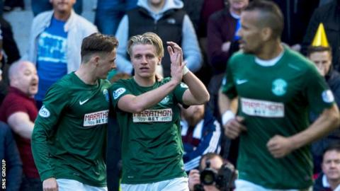Jason Cummings (centre) scored the opening goal at Easter Road