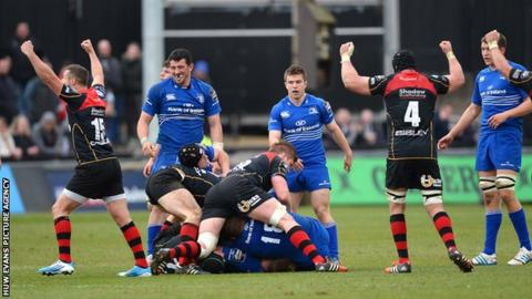 Dragons players celebrate a thrilling Pro12 win over Leinster at Rodney Parade